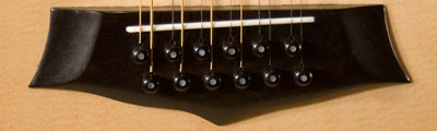 Ebony Lone Wolf 12-String Bridge.