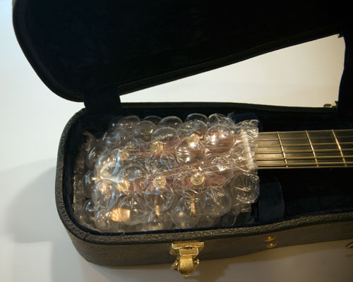 Photo of headstock wrapped in bubble wrap.